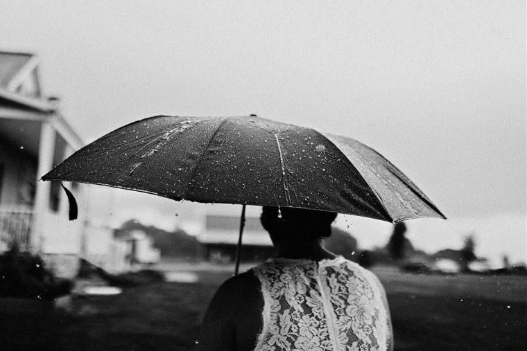Bride in rain